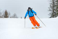 Downhill ski mountaineering - stock photo