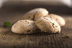 Almond cookies on wood - stock photo