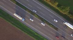 Aerial drone footage of vehicles moving on Autobahn 81 amidst farms, Heilbronn Stock Footage
