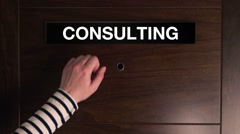 Female hand knocking on consulting door Arkistovideo