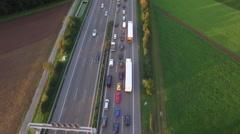 Aerial drone shot of vehicles on Autobahn 81 amidst farms, Heilbronn, Stock Footage