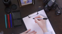A man writes a pen on paper word online Stock Footage