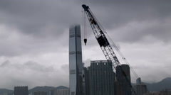 Consruction crane with fast moving clouds cityscape Stock Footage
