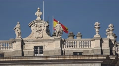 4K Beautiful Spanish architecture Madrid downtown national flag wave iconic day Stock Footage