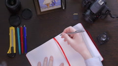 A man writes a pen in notebook Stock Footage