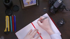 A man writes smile a pen in notebook Stock Footage