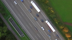 Aerial drone shot of vehicles on Autobahn 81 amidst patchwork landscape Stock Footage