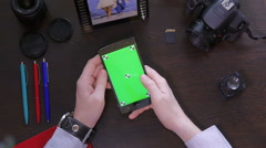 Man used mobile phone with green screen top view - stock footage