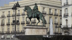 4K King Charles statue Puerta del Sol Gate Sun Madrid square public fountain day Stock Footage