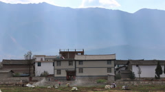 Farmers working in the fields of Heqing, a small town in Yunnan southern China Stock Footage