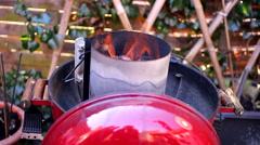 Bbq firestarter preparing grill Stock Footage