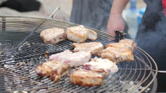Fair of street food - Chef frying beef steak on the grill grate - stock footage
