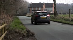 Car approaching English country pub Stock Footage