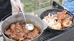 Boiling and frying a meat in a street food fair market Stock Footage