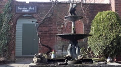 Fountain in beer garden of English country pub Stock Footage