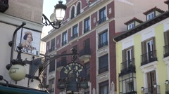 4K Famous traditional architecture Madrid old town street sign direction local  Stock Footage