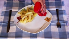 Serving Ketchup at plate Stock Footage