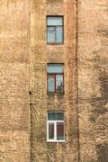 Stock Photo of Windows in a row on facade of apartment building
