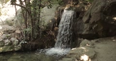 Girl near waterfall in landscaped park of Vorontsov Palace Stock Footage