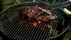 spare ribs grilling on direct heat barbecue  - stock footage