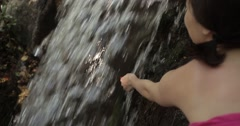 Girl touching waterfall in landscaped park of Vorontsov Palace - stock footage