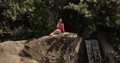 Girl posing near waterfall in landscaped park of Vorontsov Palace - stock footage