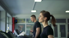 Young healthy woman running on treadmill. 4k - stock footage