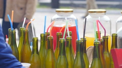 Bottled beverage drinks on a street food fair showcase counter stall - stock footage