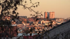 4K Aerial view Madrid downtown rooftop sunset sunrise orange light tree branch  - stock footage