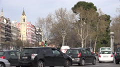 4K Heavy traffic street multiple lane Madrid downtown car pass bus pollution day Stock Footage