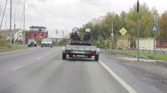 Car with a trailer traveling on the road Stock Footage