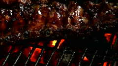 Spare ribs grilling close up Stock Footage