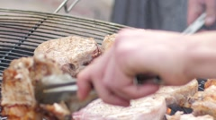 Fair of street food - Chef frying beef steak on the grill grate Stock Footage