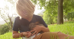 Happy child taking care of a bunny outside - stock footage
