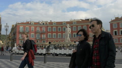 Walking by a tourist train in Place Masséna, a place of downtown Nice Stock Footage
