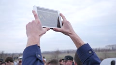 Shooting video via tablet computer camera of a public performance Stock Footage