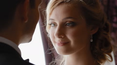 Groom kiss his bride in forehead gently - stock footage