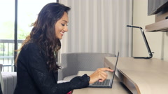 Attractive happy Indian business woman working at computer touchscreen Stock Footage