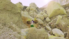 Porter is carring a basket with sulfur,Ijen volcano Stock Footage