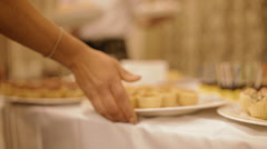 Waiter place large bowls of snacks on the table Stock Footage
