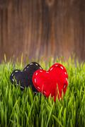 Red and black felt hearts Stock Photos