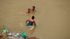 Happy Family of Myanmar people washing in Irrawaddy river Stock Footage