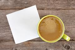 Stock Photo of Cup of coffee and blank napkin
