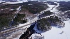 Aerial view of highway crossing a river in winter Stock Footage