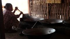 Woman prepare sweets in large bowl - Myanmar Stock Footage
