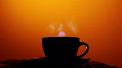 Cup silhouette with hot drink, tea or coffee.  4K shot Stock Footage
