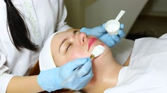 Woman, mask facial treatment at the beauty salon Stock Footage