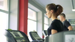Close-up of a girl on a treadmill. 4k - stock footage