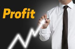profit man draws market price on touchscreen background - stock photo