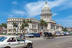 HAVANA, CUBA - APRIL 1, 2012: Heavy traffic with horse carriages, motorbikes  - stock photo
